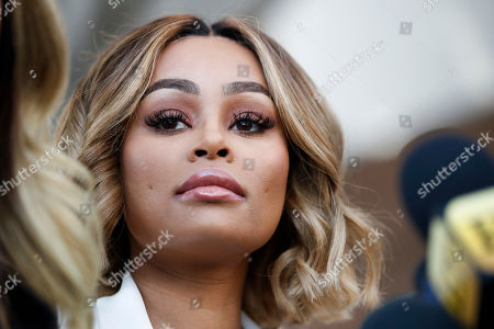 Rob Kardashian's ex-fiancee Blac Chyna listens to her attorney Lisa Bloom at a news conference after a hearing, in Los Angeles. A court commissioner has granted Chyna a temporary restraining order against the reality television star