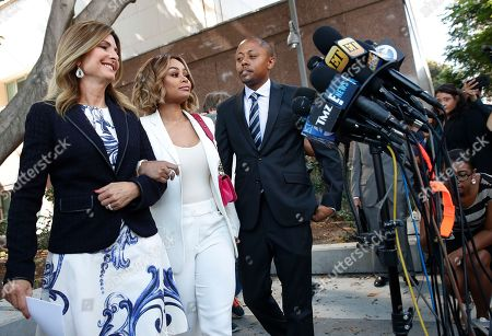 Stock Image of Blac Chyna, Lisa Bloom, Walter Mosley Rob Kardashian's ex-fiancee Blac Chyna, center, and her attorneys, Lisa Bloom, left, and Walter Mosley walk toward the mic stand, in Los Angeles. A court commissioner has granted Chyna a temporary restraining order against the reality television star