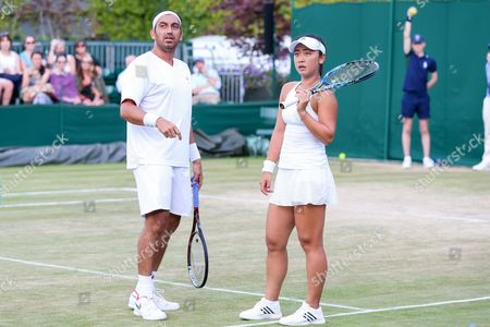 Eri Hozumi (JPN), Purav Raja (IND) - Tennis : Eri Hozumi of Japan and Purav Raja of India during the Mix doubles second round match of the Wimbledon Lawn Tennis Championships against Daniel Nestor of Canada and Andreja Klepac of Slovenia at the All England Lawn Tennis and Croquet Club in London, England.