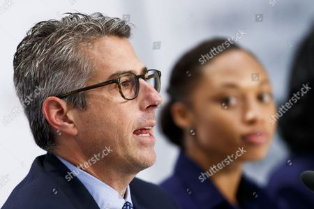 Casey Wasserman chairman of Los Angeles 2024, left, answers questions next to US Sprinter Allyson Felix, right, during a press conference after the presentation of Los Angeles 2024 Candidate City Briefing for International Olympic Committee (IOC) Members, at the SwissTech Convention Centre, in Lausanne, Switzerland, 11 July 2017.