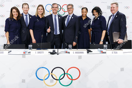 (L-R) Los Angeles 2024 Olympic bid Vice Chair and Olympic champion Janet Evans, Los Angeles 2024 CEO Gene Sykes, Head of the International Olympic Committee (IOC) athlete's commission Angela Ruggiero, Los Angeles Mayor Eric Garcetti, LA 2024 chairman Casey Wasserman, US Olympic track and field athlete Allyson Felix, IOC Vice-President Anita De Frantz and chief executive officer of the United States Olympic Committee Scott Blackmun pose for a group picture after a press conference after the presentation of Los Angeles 2024 Candidate City Briefing for International Olympic Committee (IOC) Members, at the SwissTech Convention Centre, in Lausanne, Switzerland, 11 July 2017.