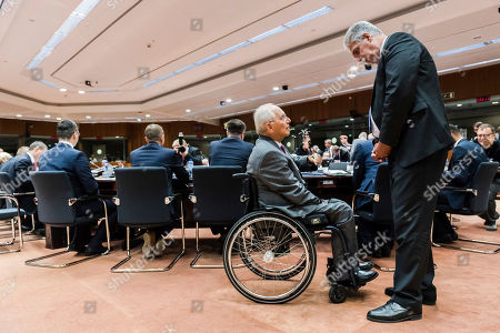 Stock Picture of Wolfgang Schauble, Hans Jorg Schelling German Finance Minister Wolfgang Schauble, left, talks with Austria's Finance Minister Hans Jorg Schelling prior to a meeting of EU finance ministers at the EU Council building in Brussels