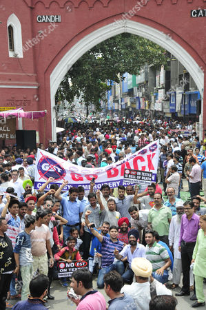 Indian textile traders and workers shout slogans as they stage a protest against the recently implemented Goods and Services Tax (GST) by the Indian government, in Amritsar, India, 11 July 2017. Media outlets report that the traders argue that a five percent rate of GST on some commodities is exorbitant and commodities had never been included in the tax bracket earlier.