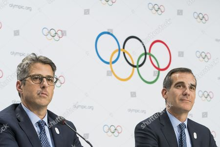 Casey Wasserman, Chairman of Los Angeles 2024, left, and Eric Garcetti, Mayor of Los Angeles, right, react during a press conference after the International Olympic Committee (IOC) Extraordinary Session, at the SwissTech Convention Centre, in Lausanne, Switzerland, Tuesday, July 11, 2017.
