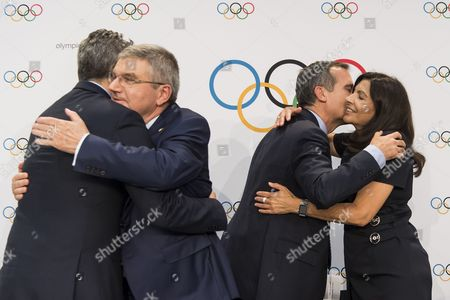 From left to right, Casey Wasserman, Chairman of Los Angeles 2024, International Olympic Committee, IOC, President Thomas Bach, from Germany, Eric Garcetti, Mayor of Los Angeles, and Anne Hidalgo, Mayor of Paris, react during a press conference after the International Olympic Committee (IOC) Extraordinary Session, at the SwissTech Convention Centre, in Lausanne, Switzerland, Tuesday, July 11, 2017.
