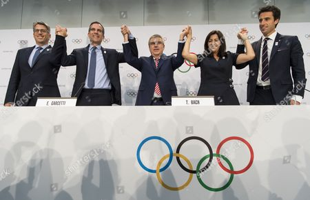 From left to right, Casey Wasserman, Chairman of Los Angeles 2024, Eric Garcetti, Mayor of Los Angeles, International Olympic Committee, IOC, President Thomas Bach, from Germany, Anne Hidalgo, Mayor of Paris, Tony Estanguet, Co-president of Paris 2024, pose together during a press conference after the International Olympic Committee (IOC) Extraordinary Session, at the SwissTech Convention Centre, in Lausanne, Switzerland, Tuesday, July 11, 2017.