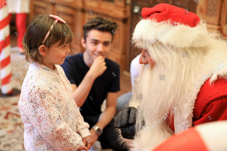 6-year-old Jessica Bryant, who was diagnosed with cancer in 2014, and her cousin singer-songwriter Nathan Sykes, meet Santa at the Cancer Research UK Kids & Teens Star Awards party, held in partnership with TK Maxx