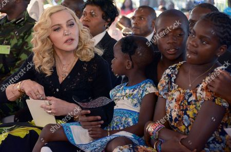 Stock Image of US musician Madonna, left, sits with her adopted children Stella, David and Mercy, at the opening of The Mercy James Institute for Pediatric Surgery and Intensive Care, located at the Queen Elizabeth Central Hospital in the city of Blantyre, Malawi, . Madonna was in Malawi on Tuesday for the official opening of a hospital children's wing funded by her charity and named after one of the four children the pop star has adopted from the impoverished southern African nation
