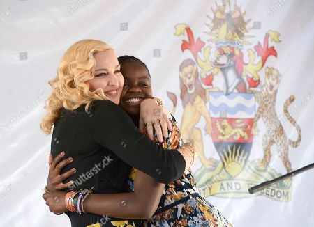US singer Madonna, hugs her adopted girl, Mercy, at the opening of The Mercy James Institute for Pediatric Surgery and Intensive Care, located at the Queen Elizabeth Central Hospital in the city of Blantyre, Malawi, . Madonna was in Malawi on Tuesday for the official opening of a hospital children's wing funded by her charity and named after one of the four children the pop star has adopted from the impoverished southern African nation