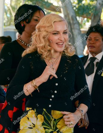 US singer Madonna smiles at the opening of The Mercy James Institute for Pediatric Surgery and Intensive Care, located at the Queen Elizabeth Central Hospital in the city of Blantyre, Malawi, . Madonna was in Malawi on Tuesday for the official opening of a hospital children's wing funded by her charity and named after one of the four children the pop star has adopted from the impoverished southern African nation