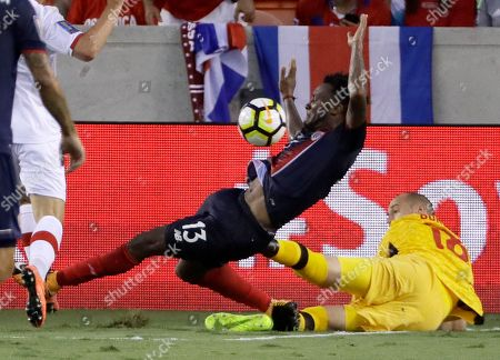 Milan Borjan, Rodney Wallace Canada goalkeeper Milan Borjan (18) stops a shot by Costa Rica midfielder Rodney Wallace (13) in the second half of a CONCACAF Gold Cup soccer match in Houston