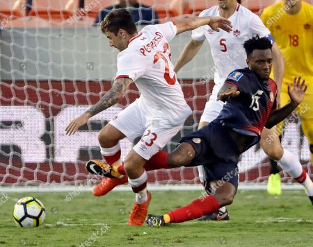 Michael Petrasso, Rodney Wallace Canada's Michael Petrasso (23) fouls Costa Rica's Rodney Wallace (13) in the second half of a CONCACAF Gold Cup soccer match in Houston