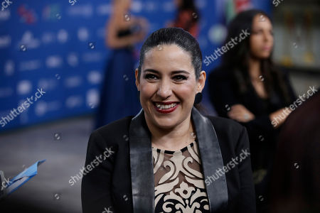 """Stock Photo of Tiare Scanda, nominee for best supporting actress for the film """"El cumple de la abuela,"""" smiles as she walks red carpet during the 59th Ariel Awards at the Palace of Fine Arts in Mexico City, . The Ariel Awards recognize excellence in motion picture making, such as acting, directing and screen writing in Mexican cinema"""