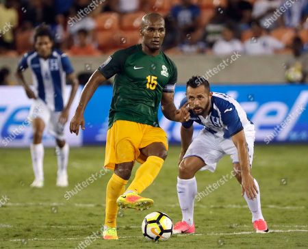 Stock Picture of Florent Malouda, Alfredo Mejia French Guiana midfielder Florent Malouda (15) controls the ball in front of Honduras midfielder Alfredo Mejia (8) in the first half of a CONCACAF Gold Cup soccer match in Houston