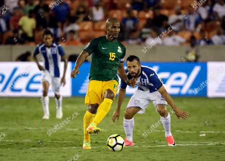 Florent Malouda, Alfredo Mejia French Guiana midfielder Florent Malouda (15) controls the ball in front of Honduras midfielder Alfredo Mejia (8) in the first half of a CONCACAF Gold Cup soccer match in Houston