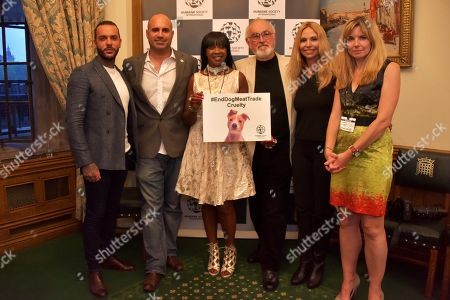 Pete Wicks, Marc Abraham, Sandi Bogle, Peter Egan, Anneka Svenska, Phillipa Tomson, Humane Society International IMAGE DISTRIBUTED FOR HUMANE SOCIETY INTERNATIONAL - On the eve of South Korea's BokNal days when over 1 million dogs will be killed and eaten, celebrities help shine a spotlight on the cruelty at a photo exhibition hosted by animal charity Humane Society International and MP for Crawley, Henry Smith, at Palace of Westminster,, in London. TOWIE's Pete Wicks, Gogglebox's Sandi Bogle, Downton Abbey's Peter Egan, wildlife presenter Anneka Svenska and TV vet Marc Abraham viewed a photo gallery depicting dogs HSI has saved from the slaughter, and watched iDog, HSI's new virtual reality campaign tool. HSI campaigns to end the dog meat trade across Asia