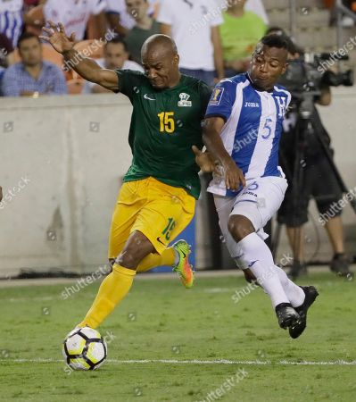 Stock Photo of Florent Malouda, Ever Alvarado French Guiana midfielder Florent Malouda (15) controls the as Honduras defenseman Ever Alvarado (5) challenges him during a CONCACAF Gold Cup soccer match, in Houston. The match ended in 0-0 tie