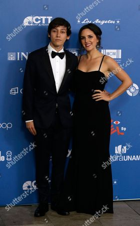 """Stock Picture of Hoze Alberto Melendez, left, who won best supporting actor for """"Almacenados,"""" poses with an unidentified date as he arrives for the 59th Ariel Awards at the Palace of Fine Arts in Mexico City, . The Ariel Awards recognize excellence in motion picture making, such as acting, directing and screen writing in Mexican cinema"""