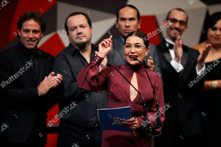 """Dolores Heredia, president of the Mexican Academy of Cinematographic Arts and Sciences, speaks as members of the cast and crew of best picture """"La 4a compania"""" stand behind her, during the closing of the 59th Ariel Awards at the Palace of Fine Arts in Mexico City, . The Ariel Awards recognize excellence in motion picture making, such as acting, directing and screen writing in Mexican cinema"""