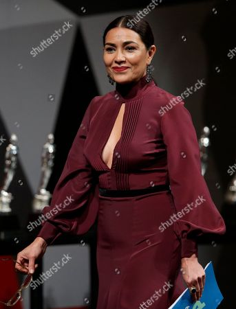 Dolores Heredia, president of the Mexican Academy of Cinematographic Arts and Sciences, walks on stage during the 59th Ariel Awards at the Palace of Fine Arts in Mexico City, . The Ariel Awards recognize excellence in motion picture making, such as acting, directing and screen writing in Mexican cinema