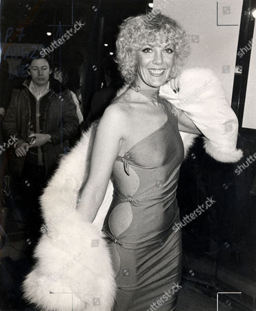 Actress Aimi Macdonald With Curly Hair And A Fur Wrap