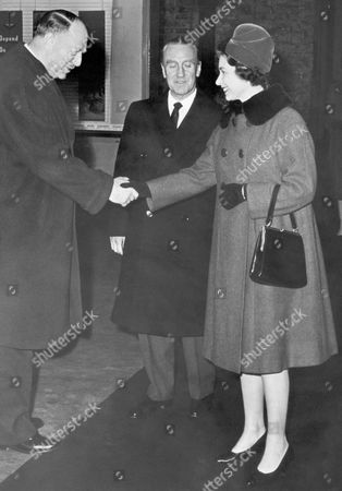Queen Elizabeth II Queen Elizabeth II Arrives At Liverpool St. Station For The Start Of Her Tour Of Eastern Region Stations. Queen Elizabeth II Being Greeted By Dr Richard Beeching Looking On Is Mr Ernest Marples. 15/2/1962