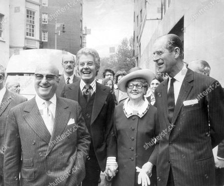 Prince Philip The Duke Of Edinburgh Looking At One Of The Two 'sunshine ' Coaches Presented By Danny La Rue At The Variety Club Luncheon At Dorchester In The Picture Is Danny's Mother And The Chief Barker Ben Rosenfield.