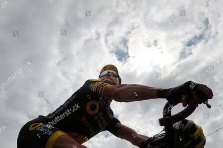 France's Thomas Voeckler rides down the ramp of the podium after signing the start list of the eleventh stage of the Tour de France cycling race over 203.5 kilometers (126.5 miles) with start in Eymet and finish in Pau, France