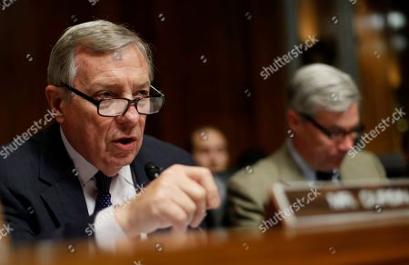 Senate Judiciary Committee member Senator Richard Durbin, D-Ill., left, accompanied by fellow committee member Senator Sheldon Whitehouse, D-R.I., speaks on Capitol Hill in Washington, during the committee's confirmation hearing for FBI Director nominee Christopher Wray
