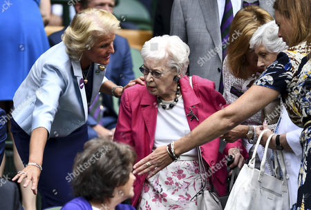 Dame June Whitfield is shown to her seat in the royal box