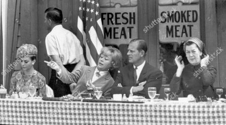 American Tour Actress Glynis Johns Calls Prince Philip's Attention To Something Happening Across The Set During A Luncheon On A Sound Stage At 20th Century Fox Studios In Hollywood Today. At Left Is Actress Natalie Wood And At Right Rosalind Russell. 1966