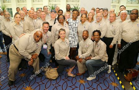 U.S. Army Captain and former Miss USA Deshauna Barber, center, meets the volunteer veteran mentors who completed the Justice For Vets National Mentor Corps Boot Camp at the 2017 NADCP Training Conference Closing Ceremony at the Gaylord National Resort and Convention Center on in Oxon Hill, Md