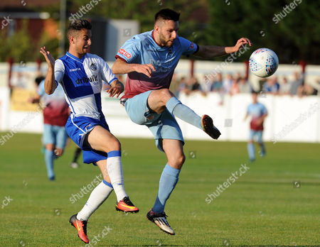 Stock Picture of Mangotsfield United's Tom Warren is challenged by Bristol Rovers' Sam Phillips