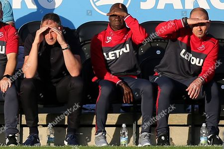 Swansea City Manager, Paul Clement watches on alongside Assistant Manager, Claude Makelele and Assistant Coach, Karl Halabi during Barnet vs Swansea City, Friendly Match Football at the Hive Stadium on 12th July 2017