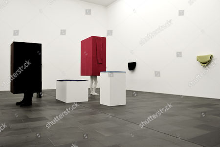 The sculpture 'Kastenmann pink' (C, Box man pink) and untitled sculptures made of wood, acrylic, plaster and wool by Austrian artist Erwin Wurm are on display at the MKM Museum Kueppersmuehle in Duisburg, Germany, 12 July 2017. In a joint exhibition, the Lehmbruck Museum and the MKM Museum Kueppersmuehle are presenting artworks by Wurm until respectively 29 October and 03 September 2017.