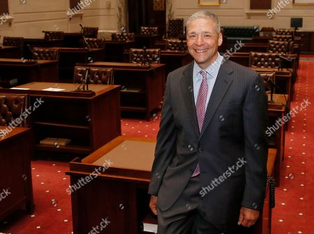 Oklahoma state Senator Michael Brooks poses for a photo on the floor of the state Senate during a tour of the state Capitol in Oklahoma City, . Brooks won his Senate seat in a special election Tuesday, July 11, 2017, held to fill the Senate district 44 seat vacated when Senator Ralph Shortey resigned