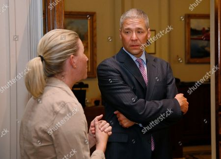 Newly-elected Oklahoma state Senator Michael Brooks, right, talks with Sarah Taylor, left, Democratic Leadership staff, during a tour of the state Capitol in Oklahoma City, . Brooks won his Senate seat in a special election Tuesday, July 11, 2017, held to fill the Senate district 44 seat vacated when Senator Ralph Shortey resigned