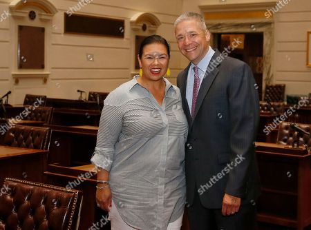 Michael Brooks, Jessica Martinez-Brooks Newly elected Oklahoma state Senator Michael Brooks, right, poses for a photo with his wife, Jessica Martinez-Brooks, left, on the floor of the state Senate during a tour of the state Capitol in Oklahoma City, . Brooks won his Senate seat in a special election Tuesday, held to fill the Senate district 44 seat vacated when Senator Ralph Shortey resigned