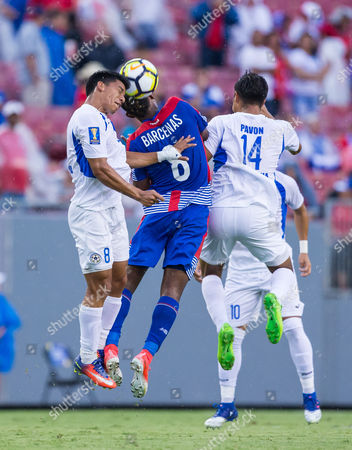 Nicaragua midfielder Marlon Lpez (8), Nicaragua forward Eulises Pavn (14) and Panama midfielder Edgar Yoel Barcenas (8) in action in a Group B match during the CONCACAF Gold Cup game between the Panama National Team and the Nicaragua National Team at Raymond James Stadium, Tampa, Florida, USA