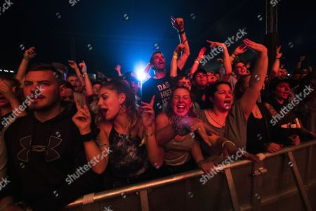 Stock Picture of Festival goers enjoy the concert by the US band House of Pain on the Zeltbuhne stage during the 34th Gurtenfestival open air music festival in Bern, Switzerland, 13 July 2017.