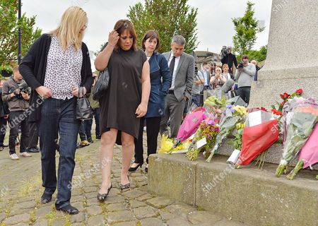 Editorial picture of Mp Paula Sherriff Mp Karen Rawlins Mp Lucy Powell And Mp Geoff Smith Lay Flowers Near The Scene Of The Attack In Birstall West Yorkshire Where Jo Cox Mp Was Killed. Pic Bruce Adams / Copy -17/6/16.