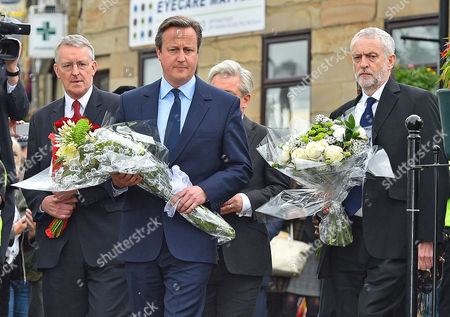 PM David Cameron Lab Party Leader Jeremy Corbyn MP (r) And Hillary Benn (l) Lay Flowers Near The Scene Of The Attack In Birstall West Yorkshire Where Jo Cox MP Was Killed. 17/6/16.