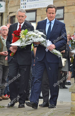 Pm David Cameron And Hillary Benn Mp (l) Lay Flowers Near The Scene Of The Attack In Birstall West Yorkshire Where Jo Cox Mp Was Killed.