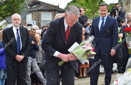 (l To R) Lab Party Leader Jeremy Corbyn MP Hillary Benn And PM David Cameron Lay Flowers Near The Scene Of The Attack In Birstall West Yorkshire Where Jo Cox MP Was Killed.-17/6/16.