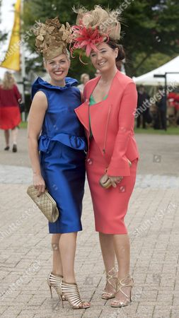 Editorial photo of Goodwood's Preferred Milliners Layla Leigh Milliners Charlie Elmy-britton And Leigh Johnson (right) Arrive At Glorious Goodwood West Sussex ... Picture Murray Sanders Daily Mail.