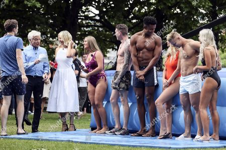 Phillip Schofield and Holly Willoughby with 'Love Island; contestants Tyne-Lexy Clarson, Craig Lawson, Nathan Joseph, Danielle Sellers, Harley Judge and Chyna Ellis filming on London's South Bank as part of 'This Morning'