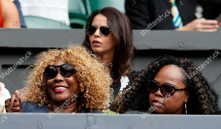 Oracene Price, left, the mother of Venus Williams of the United States sits, prior to the Women's Singles semifinal match against Britain's Johanna Konta, on day nine at the Wimbledon Tennis Championships in London