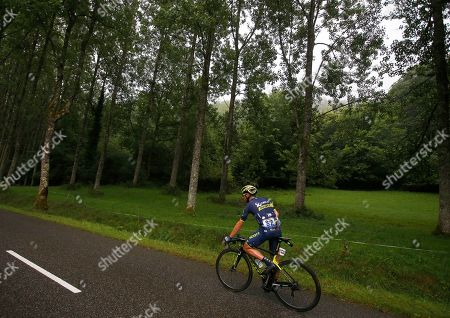 Switzerland's Michael Albasini relieves himself while riding during the twelfth stage of the Tour de France cycling race over 214.5 kilometers (133.3 miles) with start in Pau and finish in Peyragudes, France