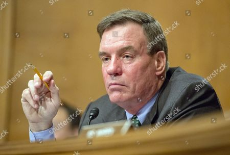 Stock Picture of United States Senator Mark Warner (Democrat of Virginia) questions Janet L. Yellen, Chair, Board of Governors of the Federal Reserve System, as she testifies before the United States Senate Committee on Banking, Housing, and Urban Affairs on 'The Semiannual Monetary Policy Report to the Congress' on Capitol Hill in Washington, DC.