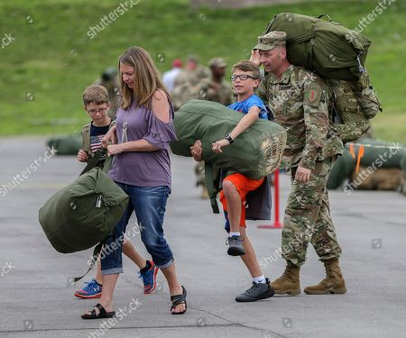 Stock Picture of Kevin Rose, Paula Rose, Caiden Rose, Noah Rose First Lt. Kevin Rose, right, gets help carrying his gear from his wife Paula and sons Noah, left, and Caiden, second right, following a welcoming ceremony in Lincoln, Neb., . About 90 Nebraska Army National Guard soldiers, members of the 1st Infantry Division Main Command Post-Operational Detachment, met their families for the first time after spending the last 9 months deployed in Iraq
